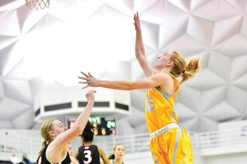 Matthew Gaston | The Sheridan Press<br>Sheridan College's Haley McDermott (25) shoots the jump shot with a high arc scoring two against Northwest Wednesday, Feb. 6, 2019.