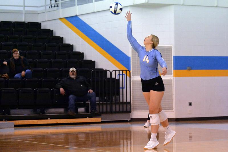 Joel Moline | The Sheridan Press<br /> Sheridan College's Jody Gallagher (14) serves the ball against Eastern Wyoming College Saturday, Nov. 2, 2019.