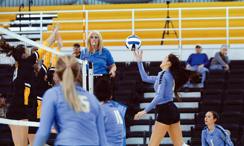 Joel Moline | The Sheridan Press<br /> Sheridan College's Keala Wright (3) tips the ball over the defense against Eastern Wyoming College Saturday, Nov. 2, 2019.