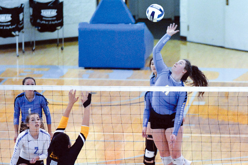 Joel Moline | The Sheridan Press<br /> Sheridan College's Cayl Bowman (11) rises for the kill against Eastern Wyoming College Saturday, Nov. 2, 2019.