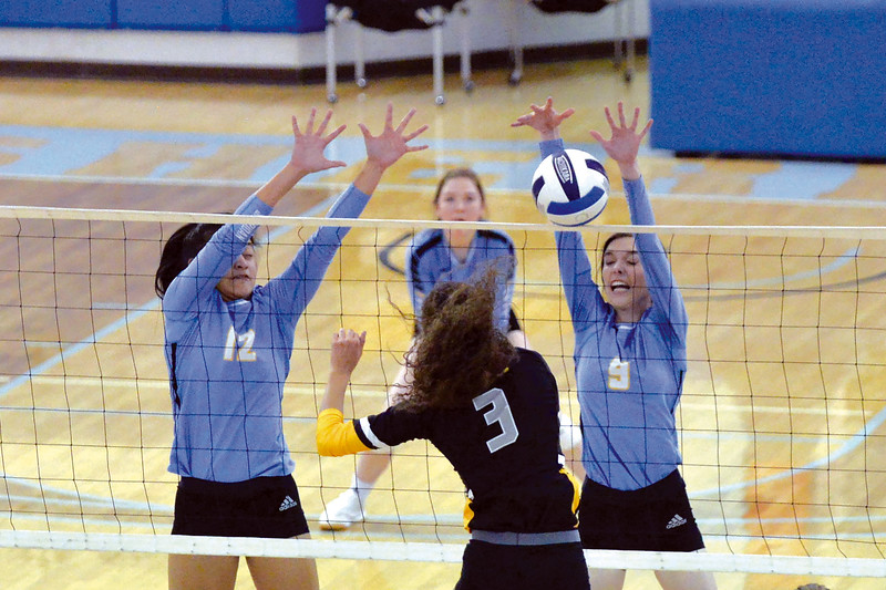 Joel Moline | The Sheridan Press<br /> Sheridan College's Emily Baumstarck (9) rejects the ball at the net against Eastern Wyoming College Saturday, Nov. 2, 2019.