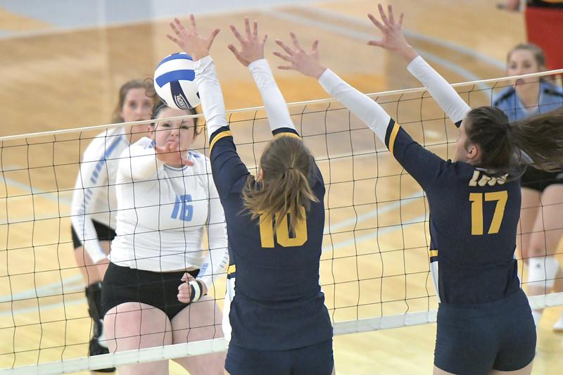 Matthew Gaston | The Sheridan Press<br>Sheridan College's Saige Jones (16) spikes the ball off Laramie County Community College's Sidney Wilson's (10) arm Friday, Nov. 1, 2019.