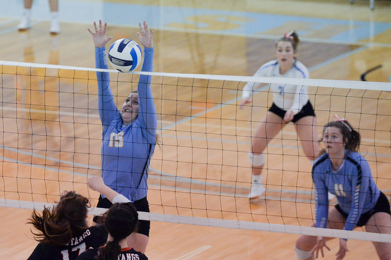 Joel Moline | The Sheridan Press<br /> Sheridan's College's Darcie Kaiser (15) blocks the ball against Western Wyoming Saturday, Oct. 26, 2019.