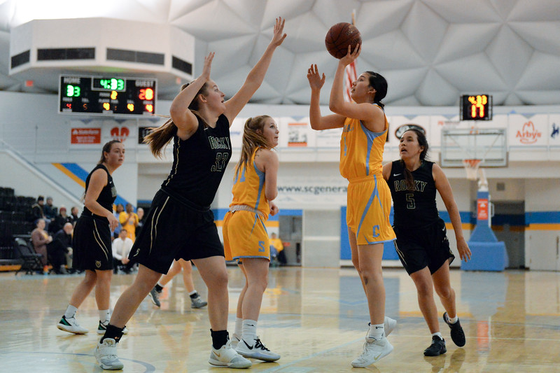 Joel Moline | The Sheridan Press<br /> Sheridan College's Alexandria Trosper (4) shoots a floater above the defense against Rocky Mountain College, Friday, Nov. 29.