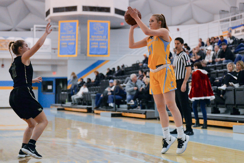 Joel Moline | The Sheridan Press<br /> Sheridan College's Shelby Tarter (31) makes a 3-pointer against Rocky Mountain College, Friday, Nov. 29.