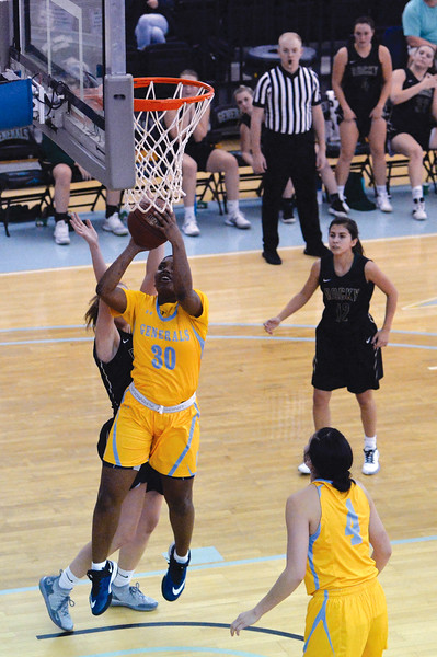 Joel Moline | The Sheridan Press<br /> Sheridan College's Cynthia Green (30) fights through contact to score two points against Rocky Mountain College Friday, Nov. 29, 2019.