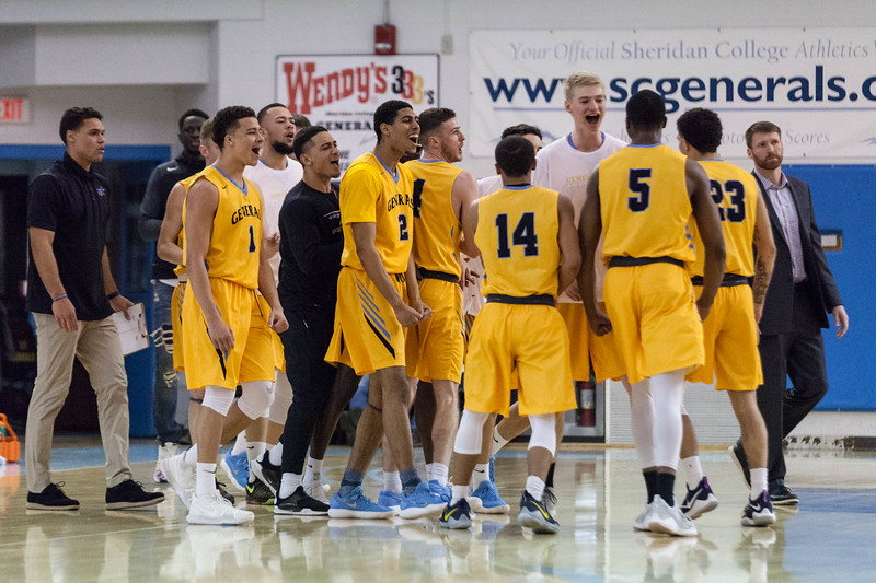 Tibby McDowell | The Sheridan Press<br /> <br /> The team comes off the bench to celebrate a dunk by Camron Reece against the Central Wyoming College Rustlers at Sheridan College on Wednesday, January 10, 2018.