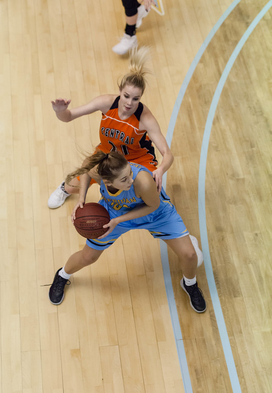 Tibby McDowell | The Sheridan Press<br /> <br /> Ashley Frampton (24) defends off Central's Aloma Solovi just before passing the ball under the basket at Sheridan College on Wednesday, January 10, 2018.