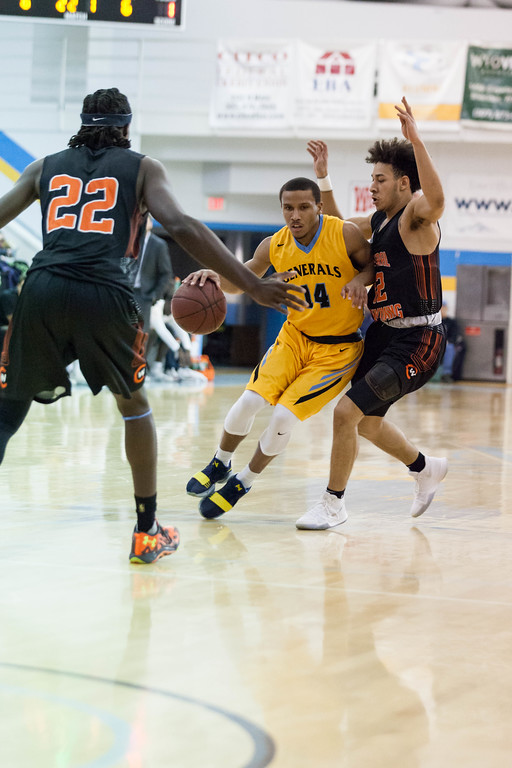 Tibby McDowell | The Sheridan Press<br /> <br /> Josh Bagley sweeps past Central's Irshaad Hunte and Jamison Washington on his way to the basket at Sheridan College Wednesday, January 10, 2018.