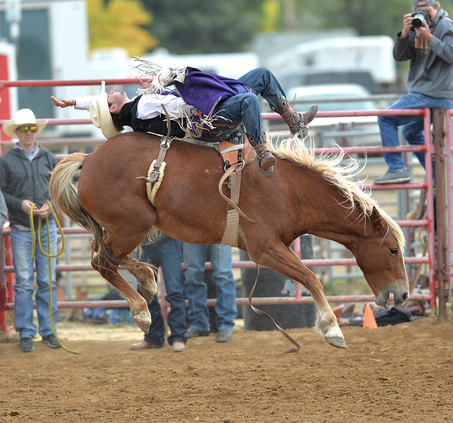 Bud Denega | The Sheridan Press<br /> Sheridan College's Cole Reiner competes in bareback during the Pat Hamilton Memorial Rodeo at the Sheridan County Fairgrounds Sunday, Sept. 23, 2018. Reiner's 84-point short-round ride earned him the top spot.