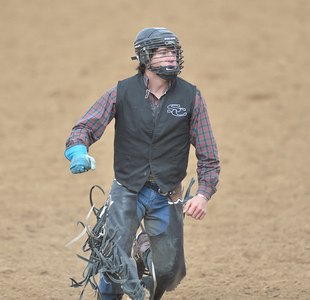Bud Denega   The Sheridan Press<br /> Sheridan College's Coby Johnson runs off the arena floor after competing in bull riding during the Pat Hamilton Memorial Rodeo at the Sheridan County Fairgrounds Sunday, Sept. 23, 2018.