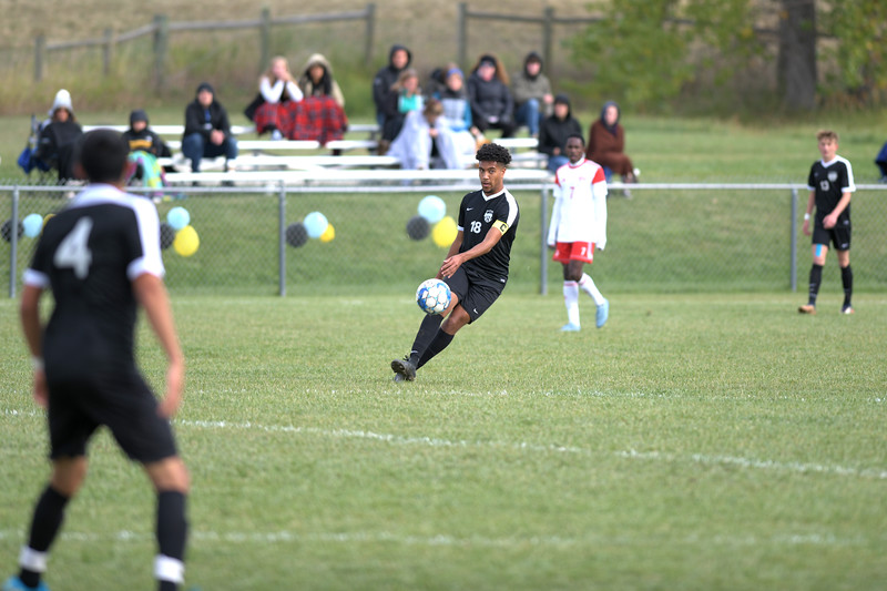 Matthew Gaston | The Sheridan Press<br>Sheridan's Marques Scott (18) chips a pass across the pitch to the far side of the box during a fast paced game against Northwest College Saturday, Oct. 5, 2019.