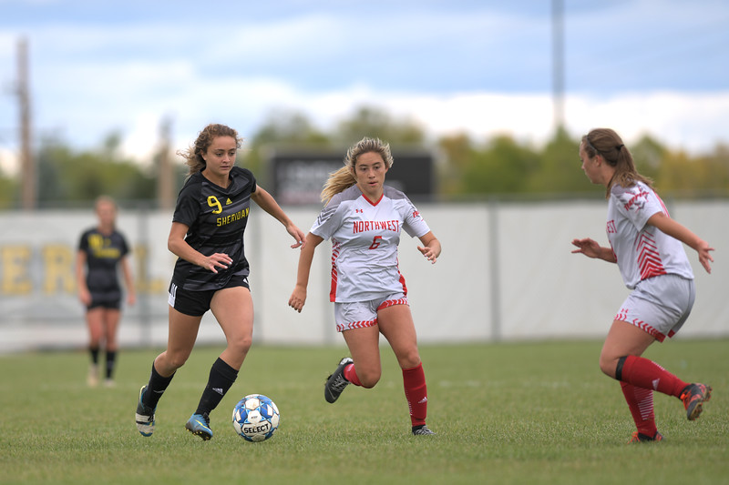 Matthew Gaston | The Sheridan Press<br>Sheridan College's Chelsea Thornburgh (9) dribbles down the pitch with two defenders form Northwest College running to challenge Saturday, Oct. 5, 2019. The Lady Generals won 13-0.