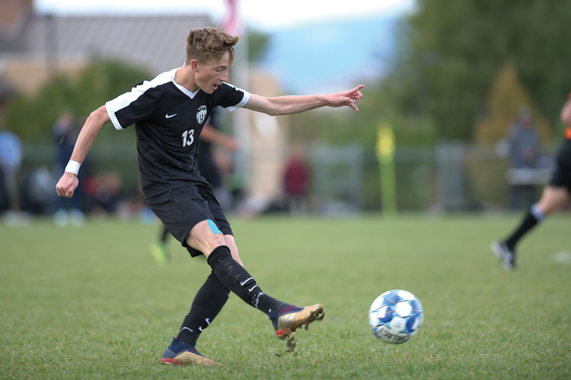 Matthew Gaston | The Sheridan Press<br>Sheridan College's Carter Wells (13) clears the ball down the pitch at Maier Field Saturday, Oct. 5, 2019.