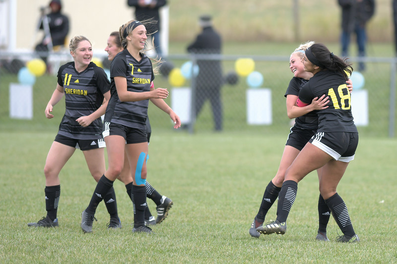 Matthew Gaston | The Sheridan Press<br>Sheridan College's Eyker Millan (18) hugs teammate Chezney Mamalis (4) after Mamalis scores a goal against Northwest College Saturday, Oct. 5, 2019. The Lady Generals won 13-0.