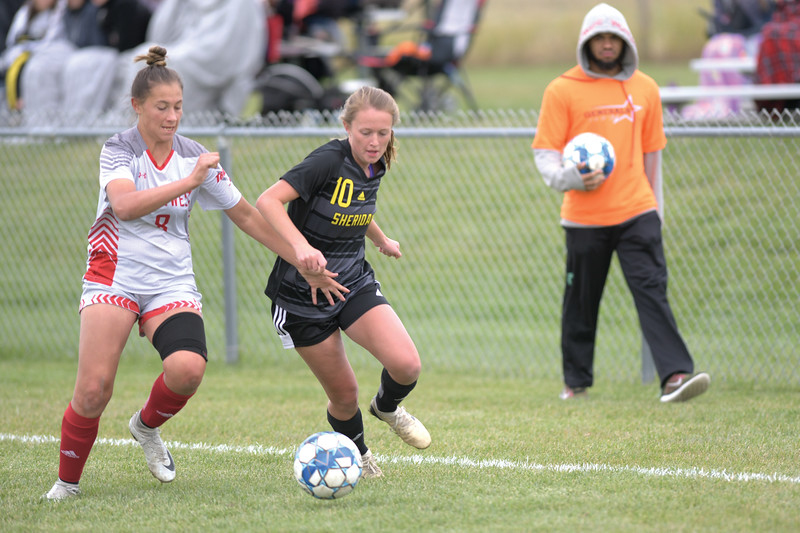 Matthew Gaston | The Sheridan Press<br>Sheridan College's Casey Wassum (10) battles for control of the ball on the pitch at Maier Field during the game with Northwest College Saturday, Oct. 5, 2019.