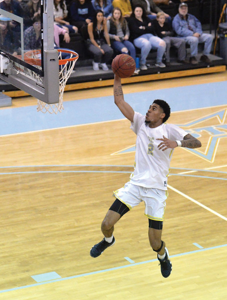 Bud Denega | The Sheridan Press<br /> Sheridan College's AJ Bramah rises for a dunk during the Generals' game against Central Wyoming College at the Bruce Hoffman Golden Dome Saturday, Feb. 16, 2019.