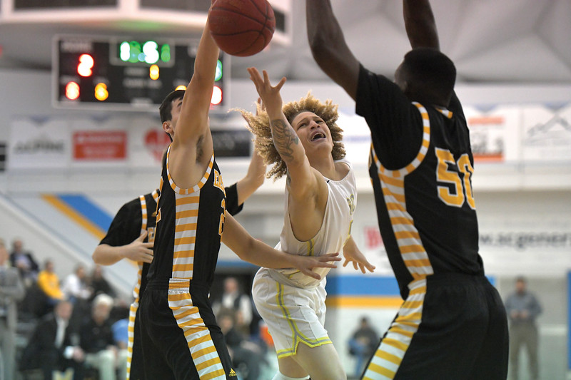 Matthew Gaston | The Sheridan Press<br>Sheridan College's Brett Thompson (5) drives the lane and is fouled hard during play against Eastern Wyoming College Wednesday, Jan. 8, 2020.