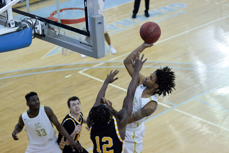 Joel Moline | The Sheridan Press<br /> Sheridan College's Marcus Stephens (1) scores a contested shot from close range against Eastern Wyoming College, Wednesday, Jan. 8, 2020.