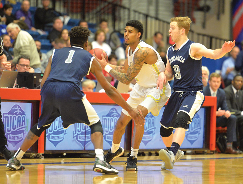 Bud Denega | The Sheridan Press<br /> Sheridan College's AJ Bramah handles the ball in traffic during the Generals' game against Kaskaskia College at the NJCAA tournament Monday, March 18, 2019.