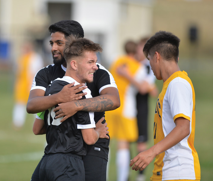 Bud Denega | The Sheridan Press<br /> Sheridan College's Aaron Ubhi, left, celebrates with Brad Whiles during the Generals' Region IX match against Laramie County Community College Saturday, Sept. 22, 2018. Sheridan edged LCCC 1-0.