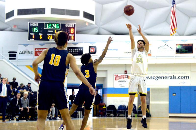Joel moline | The Sheridan Press<br /> Sheridan College's Jaren Fritz (34) attempts a 3-pointer against Laramie County Community College Saturday, Jan. 18, 2020.