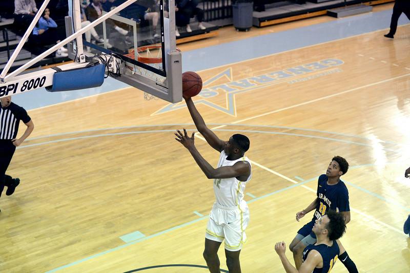 Joel moline | The Sheridan Press<br /> Sheridan College's Aaron Badibo (12) scores a layup against Laramie County Community College Saturday, Jan. 18, 2020.