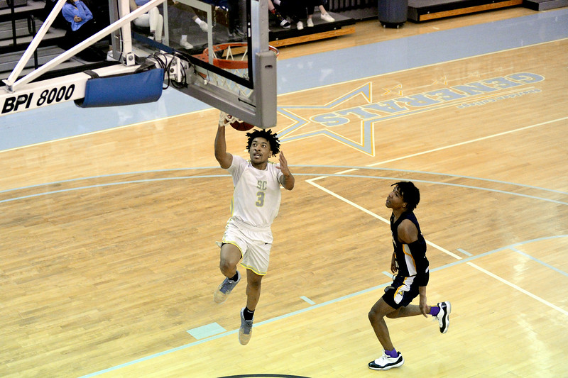 Joel moline | The Sheridan Press<br /> Sheridan College's Jovon McClanahan (3) scores a layup against Laramie County Community College Saturday, Jan. 18, 2020.