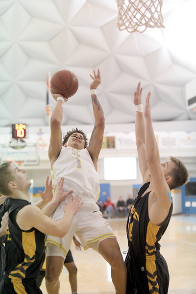 Matthew Gaston | The Sheridan Press<br>Despite the blantant foul, Sheridan College's Sean Sutherlin (1) scores two against North Platte Community College at the Bruce Hoffman Golden Dome Friday, March 8, 2019. The Generals won 95-88.