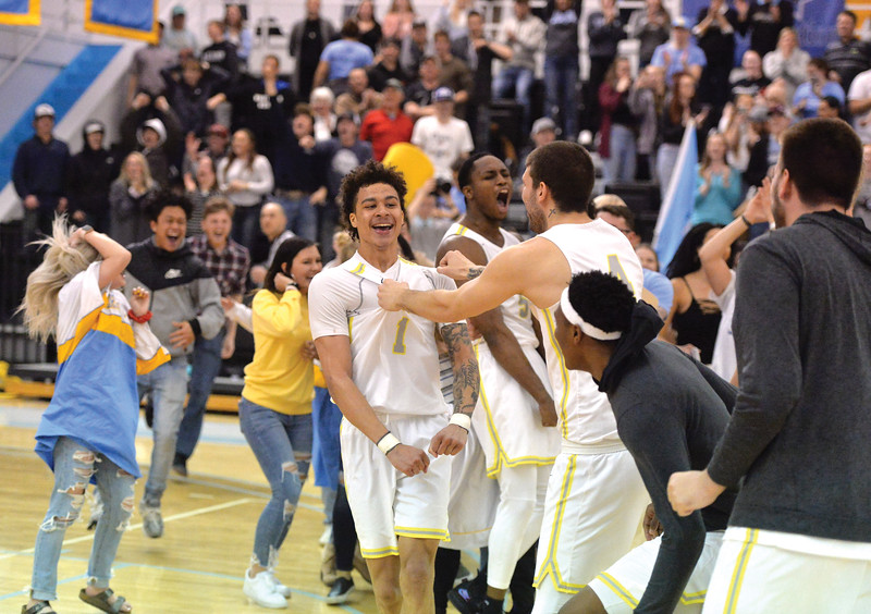 Bud Denega | The Sheridan Press<br /> Sheridan College's Sean Sutherlin celebrates with teammates and fans after the Generals edged Northeastern Junior College 74-72 in the Region IX tournament quarterfinals inside the Bruce Hoffman Golden Dome Thursday, March 7, 2019.