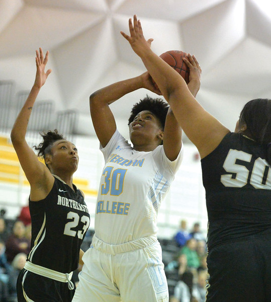 Bud Denega | The Sheridan Press<br /> Sheridan College's Cynthia Green holds the ball in traffic during a game against Northeastern Junior College at the Bruce Hoffman Golden Dome Saturday, Jan. 5, 2019.