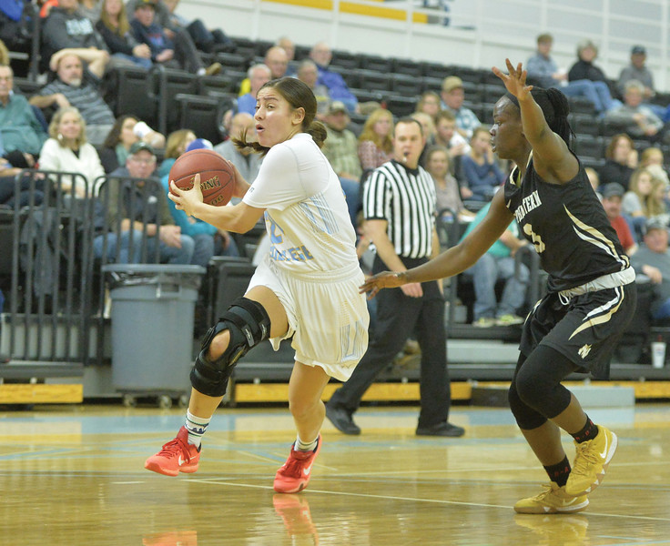 Bud Denega | The Sheridan Press<br /> Sheridan College's Aloma Solovi drives during a game against Northeastern Junior College at the Bruce Hoffman Golden Dome Saturday, Jan. 5, 2019.
