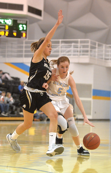 Bud Denega | The Sheridan Press<br /> Sheridan College's Darcy Walker handles the ball during a game against Northeastern Junior College at the Bruce Hoffman Golden Dome Saturday, Jan. 5, 2019.
