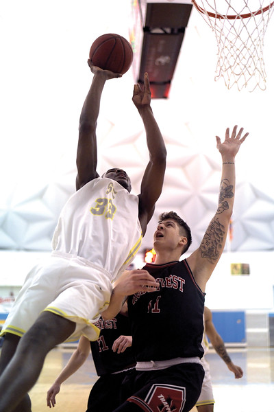Matthew Gaston | The Sheridan Press<br>Sheridan College's Abdul Shanunu (33) makes the off balance shot from underneath during play against Northwest Wednesday, Feb. 19, 2020.