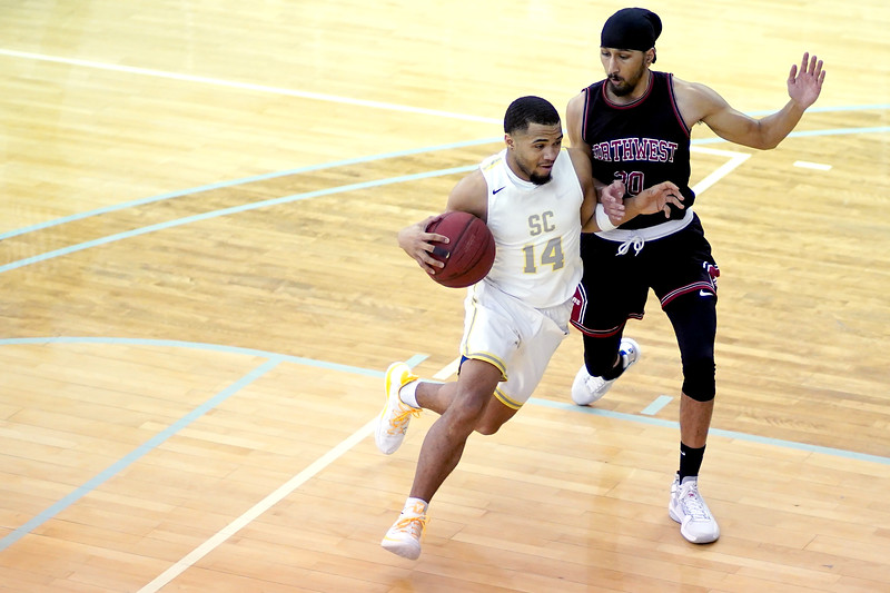 Matthew Gaston | The Sheridan Press<br>Sheridan College's Markel Aune (14) drives the lane against Northwest's Rambo Badyal (20) during the Generals 94-82 victory Wednesday, Feb. 19, 2020.