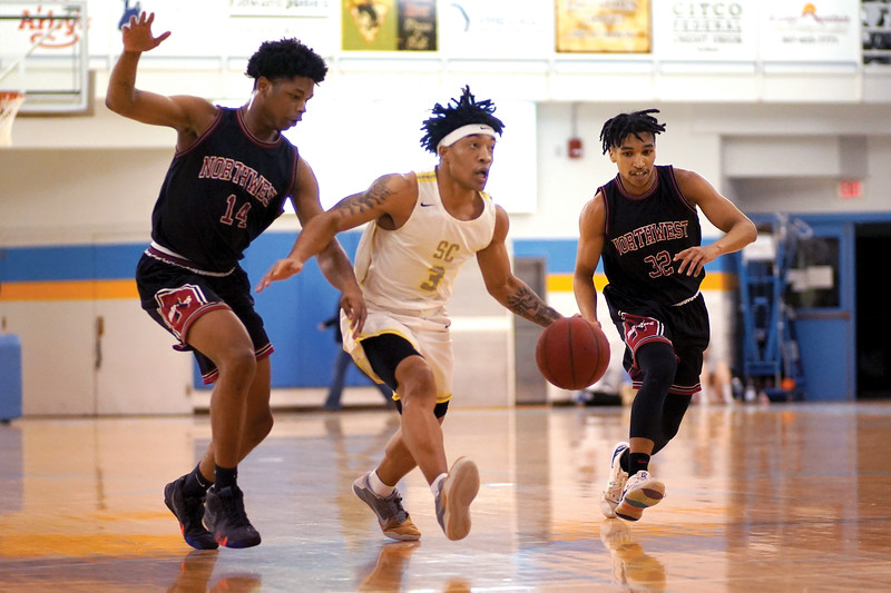 Matthew Gaston | The Sheridan Press<br>Sheridan College's JoVon McClanahan (3) breaks down court with defenders from Northwest hot on his heels Wednesday, Feb. 19, 2020. The Generals won 94- 82.