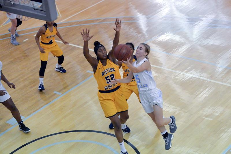 Joel Moline | The Sheridan Press<br /> Sheridan College's Haley McDermott (5) avoids the defense to score a layup against Western Nebraska Community College Tuesday, Nov. 5, 2019.