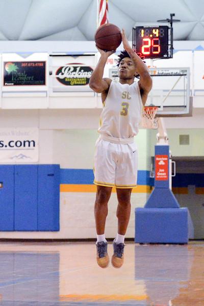 Joel Moline | The Sheridan Press<br /> Sheridan College's JoVon McClanahan (3) shoots a wide open 3-pointer against Western Nebraska Community College Tuesday, Nov. 5, 2019.