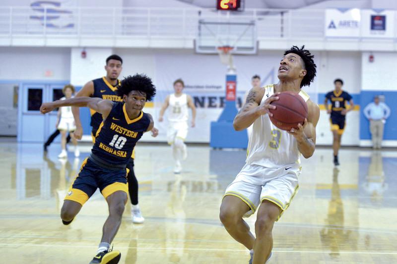 Joel Moline | The Sheridan Press<br /> Sheridan College's JoVon McClanahan (3) drives in for a layup against Western Nebraska Community College Tuesday, Nov. 5, 2019.