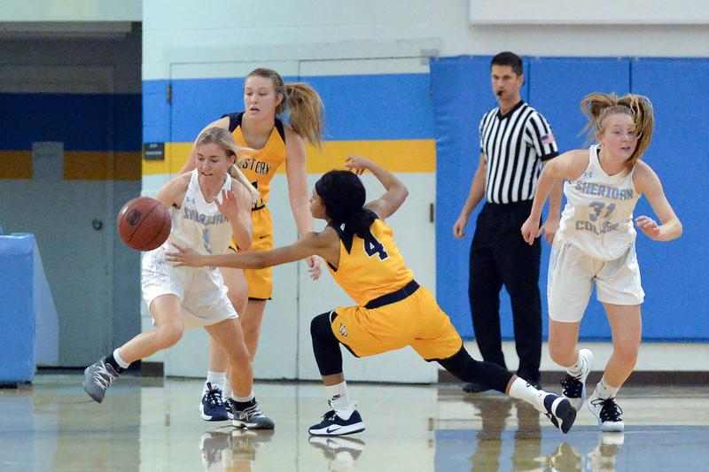 Joel Moline | The Sheridan Press<br /> Sheridan College's Haley McDermott (5) steals the ball against Western Nebraska Community College Tuesday, Nov. 5, 2019.