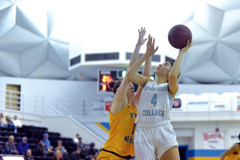 Joel Moline | The Sheridan Press<br /> Sheridan College's Alexandria Trosper (4) fights through to score a layup against Western Nebraska Community College Tuesday, Nov. 5, 2019. .