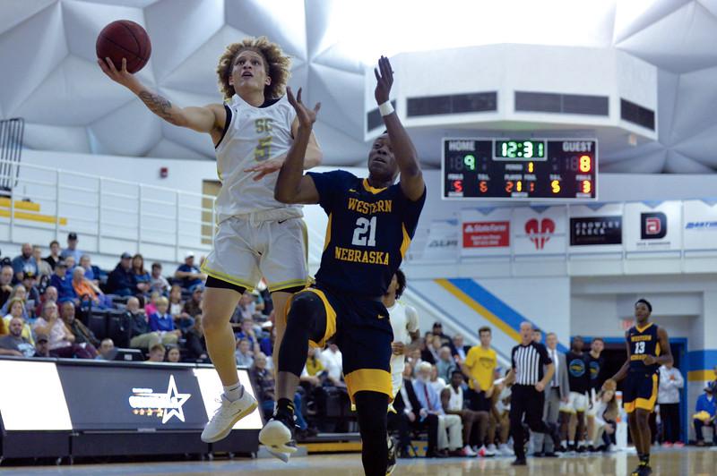 Joel Moline | The Sheridan Press<br /> Sheridan College's Brett Thompson (5) sneaks past the defense for a layup against Western Nebraska Community College Tuesday, Nov. 5, 2019.