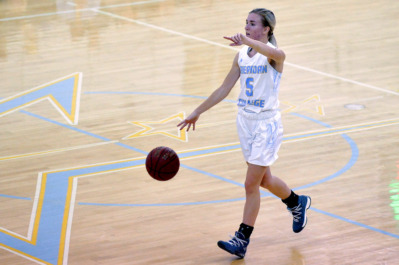 Joel Moline | The Sheridan Press<br /> Sheridan College's Haley McDermott (5) sets up the offense against Rocky Mountain College Friday, Nov. 1, 2019.