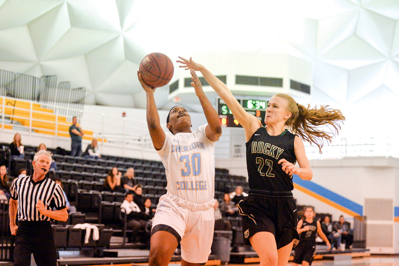 Joel Moline | The Sheridan Press<br>Sheridan College's Cynthia Green (30) goes up for a layup with pressure from Rocky Mountain College's Hailey Armus (22) at the Bruce Hoffman Golden Dome Friday, Nov. 1, 2019.