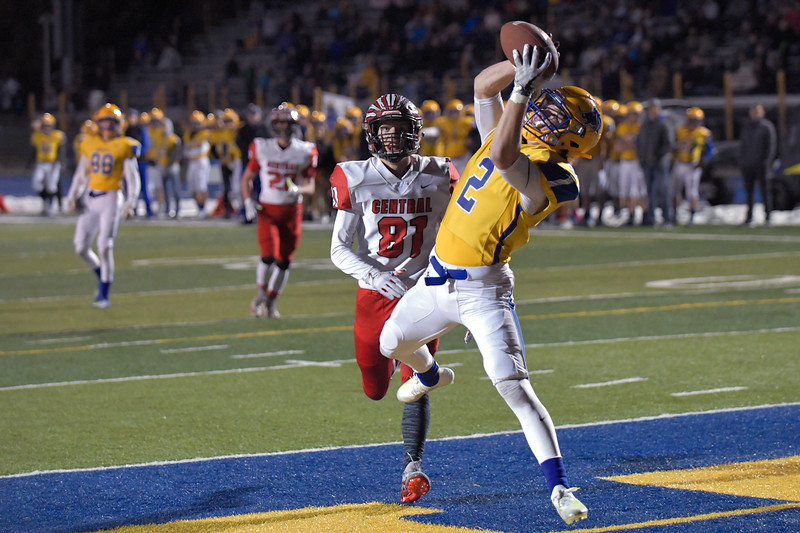 Joel Moline | The Sheridan Press<br /> Sheridan's Toby Jacobs (2) jumps into the air top haul in a touchdown against Cheyenne Central Friday, Nov. 8, 2019. Sheridan qualified for the state title game after defeating Cheyenne Central 62-35.