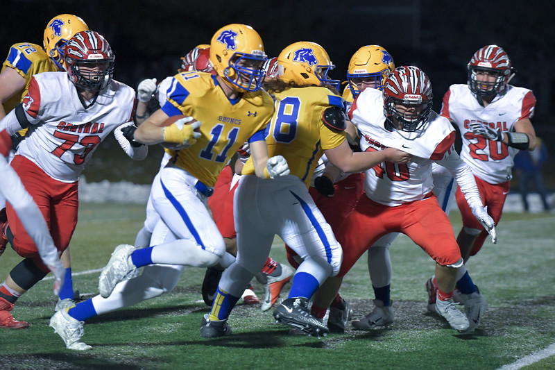 Joel Moline | The Sheridan Press<br /> Sheridan's Izak Aksamit (11) rushes past the line of scrimmage against Cheyenne Central Friday, Nov. 8, 2019.