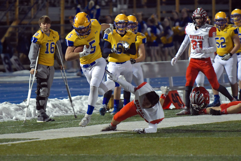 Joel Moline | The Sheridan Press<br /> Sheridan's Garrett Coon (5) is finally forced out of bounds after picking up a big gain against Cheyenne Central Friday, Nov. 8, 2019. Sheridan qualified for the state title game after defeating Cheyenne Central 62-35.