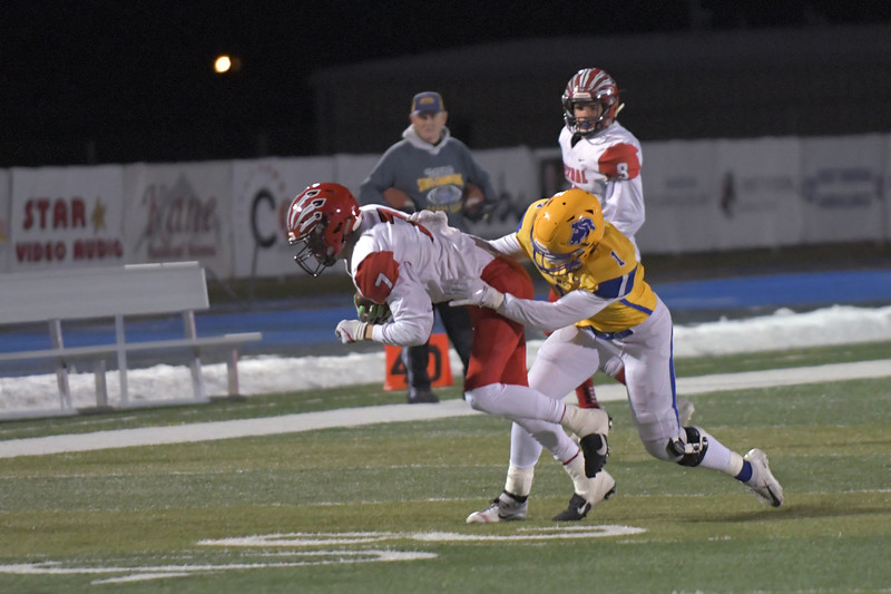 Joel Moline | The Sheridan Press<br /> Sheridan's Ryan Sessions (1) shoves the receiver to the ground against Cheyenne Central Friday, Nov. 8, 2019.