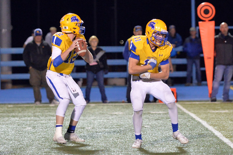 Joel Moline | The Sheridan Press<br /> Sheridan's Jacob Boint (12) drops back to pass after faking a handoff to Izak Aksamit (11)  against East Friday, Oct. 24, 2019.