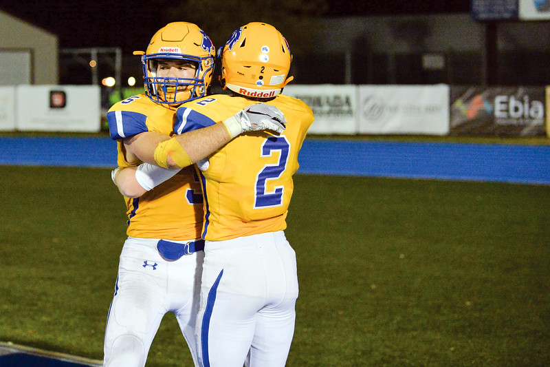 Joel Moline | The Sheridan Press<br>Sheridan's Garrett Coon (5) embraces teammate Toby Jacobs (2) after a touchdown in action against Cheyenne East Friday, Oct. 25, 2019.
